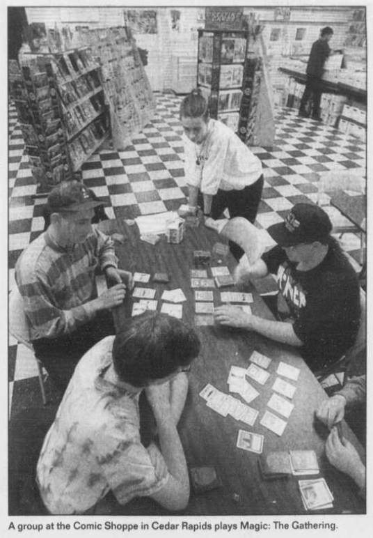 """The Comic Shoppe Plus"" would later move across town and become just ""Comic Shoppe."" It was featured here on a front page story by The Gazette (Sun., 02/19/1995) covering the explosive growth of MTG. That black & white checkered floor is seared into my memory."